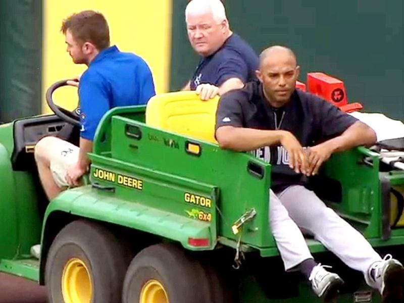 In this image taken from video, New York Yankees' Mariano Rivera (R) is being carted off the field after twisting his right knee shagging fly balls during batting practice before a baseball game with the Kansas City Royals in Kansas City. AP Photo/YES Network