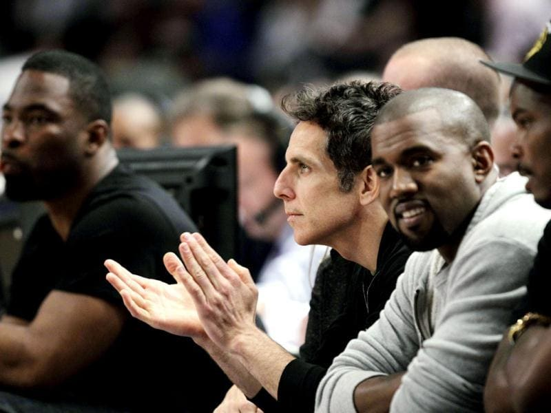 Actor Ben Stiller (2nd from L) applauds alongside New York Giants' Justin Tuck (L) and rapper Kanye West (2nd from R) as they watch Game 3 of an NBA basketball first-round playoff series between the Miami Heat and New York Knicks at Madison Square Garden. AP Photo/Kathy Willens
