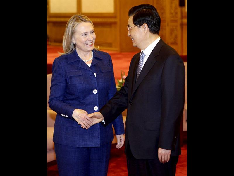 US secretary of state Hillary Rodham Clinton (L) shakes hands with Chinese President Hu Jintao prior to a meeting at the Great Hall of the People in Beijing. AP Photo/Jason Lee, Pool