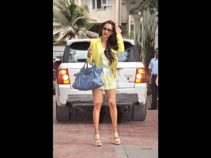 Malaika looked cool in the yellow summery dress.