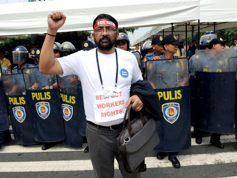Foreign delegates to the Asian Development Bank (ADB) board of governors annual meeting hold a silent protest in support of workers rights in front of the venue of the meeting, in Manila. The Philippines bristled on May 4, at allegations it tried to