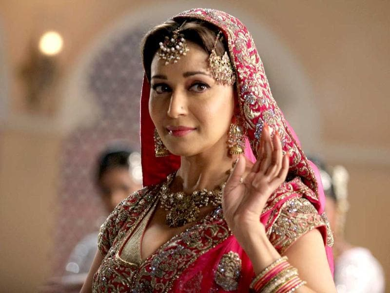 Madhuri Dixit is seen in a pink attire, similar to what Meena Kumari wore in the mujra from Pakeezah.