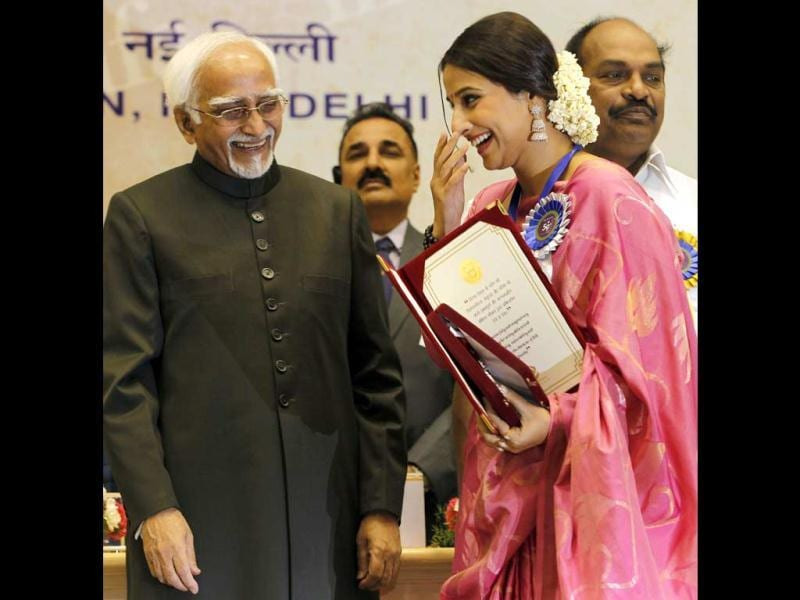 Vidya smiles onstage as she receives the award. (AP Photo)