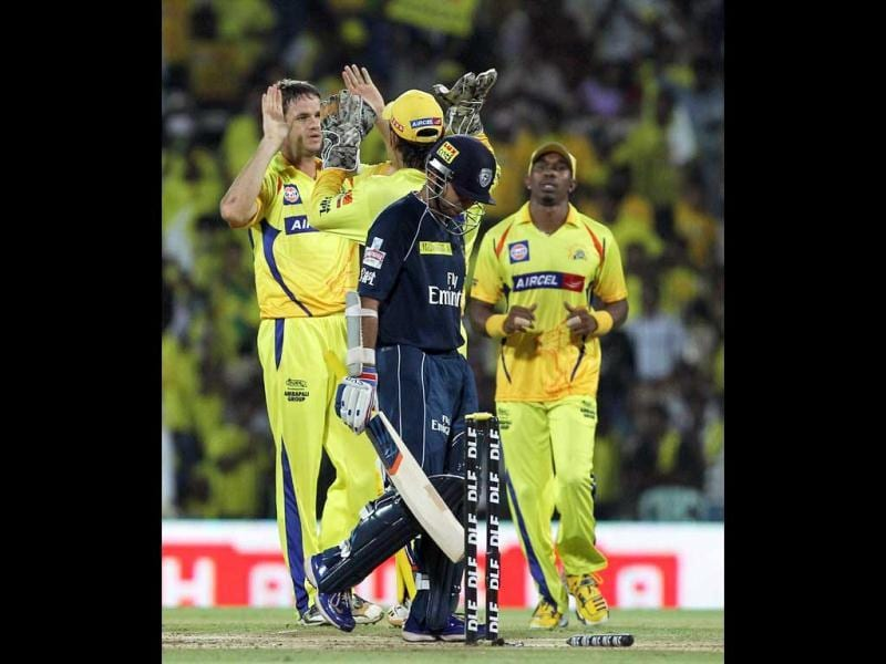 Chennai Super Kings' Albie Morkel celebrate with teammates after taking wicket of Deccan Chargers' Parthiv Patel during the IPL5 match in Chennai. PTI Photo/R Senthil Kumar