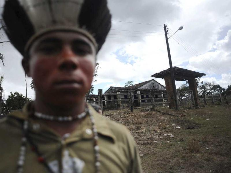 A Pataxo Indian stands in front of the Rancho Alegre ranch abandoned by its non-Indian owners in the Pau Brasil reserve, southern Bahia state. Reuters/Lunae Parracho