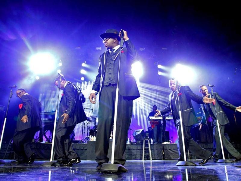 Bobby Brown (C) performs with New Edition at the Tampa Bay Times Forum in Tampa, Fla. AP Photo/The Tampa Bay Times, Daniel Wallace