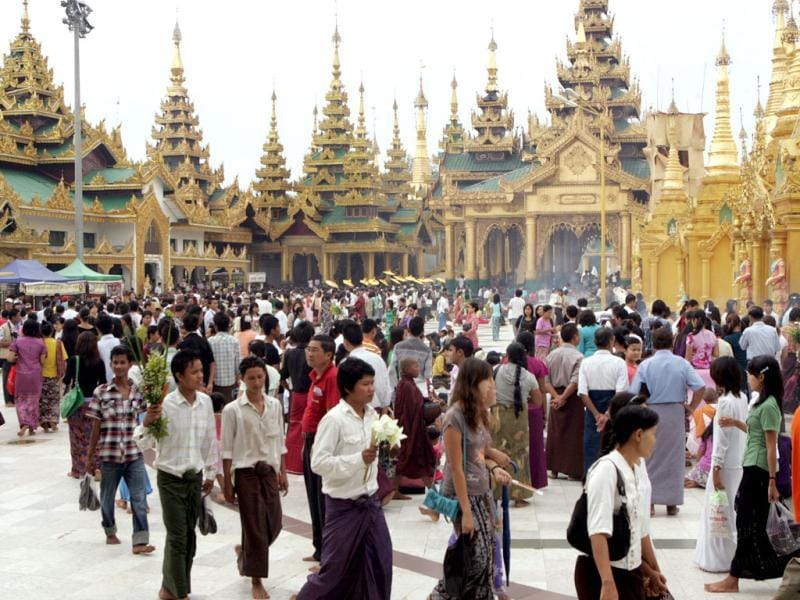 Buddhist devotees pay a visit to Myanmar's fame Shwedagon Pagoda on the full-moon day of Kasone, the second month of Myanmar Calendar. in Yangon, Myanmar. (AP Photo/Khin Maung Win)