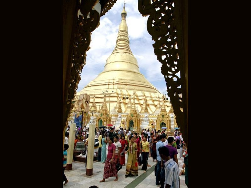 Buddhist devotees pay a visit to Myanmar's famed Shwedagon Pagoda on the full-moon day of Kasone, the second month of Myanmar Calendar in Yangon, Myanmar. (AP Photo/Khin Maung Win)