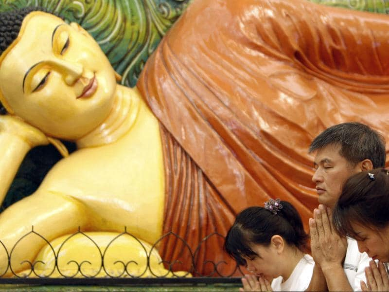 Buddhist devotees offer prayers in front of a Buddha statue during Wesak Day, known as Buddha's birthday, at Buddhist Maha Vihara Temple in Kuala Lumpur, Malaysia. (AP Photo/Lai Seng Sin)