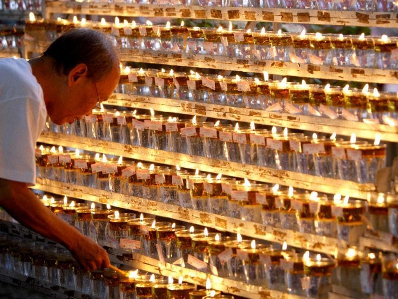 A Buddhist devotee lights oil lamps during Wesak Day, known as Buddha's birthday, at Buddhist Maha Vihara Temple in Kuala Lumpur, Malaysia. (AP Photo/Lai Seng Sin)