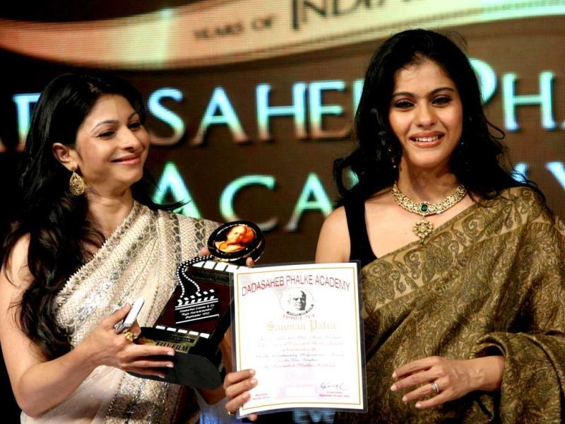 Indian Bollywood actress Kajol (R) and her sister Tanisha (L) attend the 143rd Dadasaheb Phalke Academy Awards 2012 ceremony, celebrating Indian Cinema.