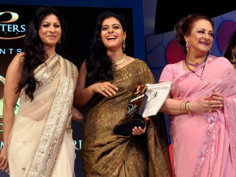 Bollywood actor Kajol (C) with sister Tanisha (L) and yesteryear star Saira Banu at the prestigious event.