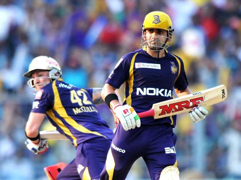 Kolkata Knight Riders batsman Gautam Gambhir (R) and Brendon McCullum run between wickets during the IPL Twenty20 cricket match between Kolkata Knight Riders and Pune Warriors India at The Eden Gardens in Kolkata. AFP Photo/Dibyangshu Sarkar