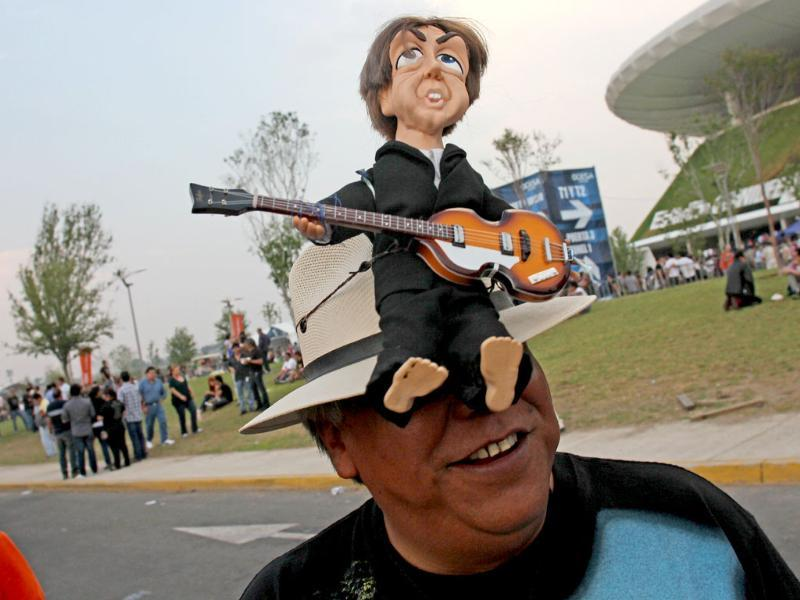 A fan of Paul McCartney waits outside the Omnilife Stadium in Guadalajara, Mexico before the start of On The Run tour. AFP/Hector Guerrero