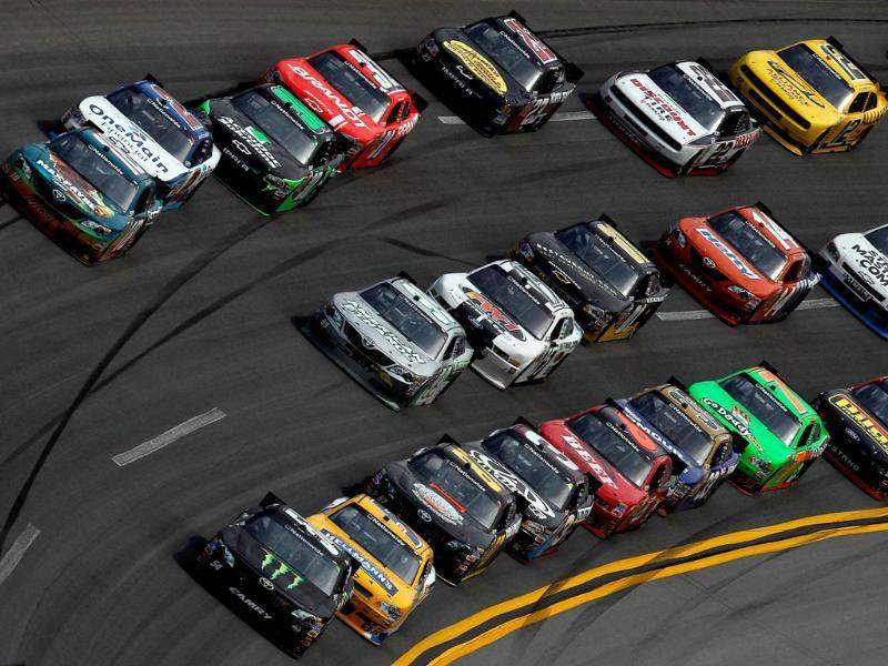 Kyle Busch, driver of the #54 Monster Energy Toyota, leads a group of cars during the NASCAR Nationwide Series Aaron's 312 at Talladega Superspeedway in Talladega, Alabama. AFP/Tom Pennington