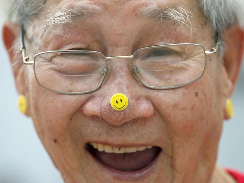 A man practises laughter yoga during the World Laughter Day celebrations in Hong Kong. Reuters/Tyrone Siu