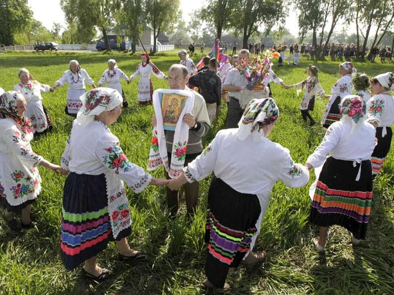 Villagers in traditional clothes dance during a ritual celebrating the pagan god Yurya in the village of Pogost, some 250 km (155 miles) south of Minsk. REUTERS/Vasily Fedosenko