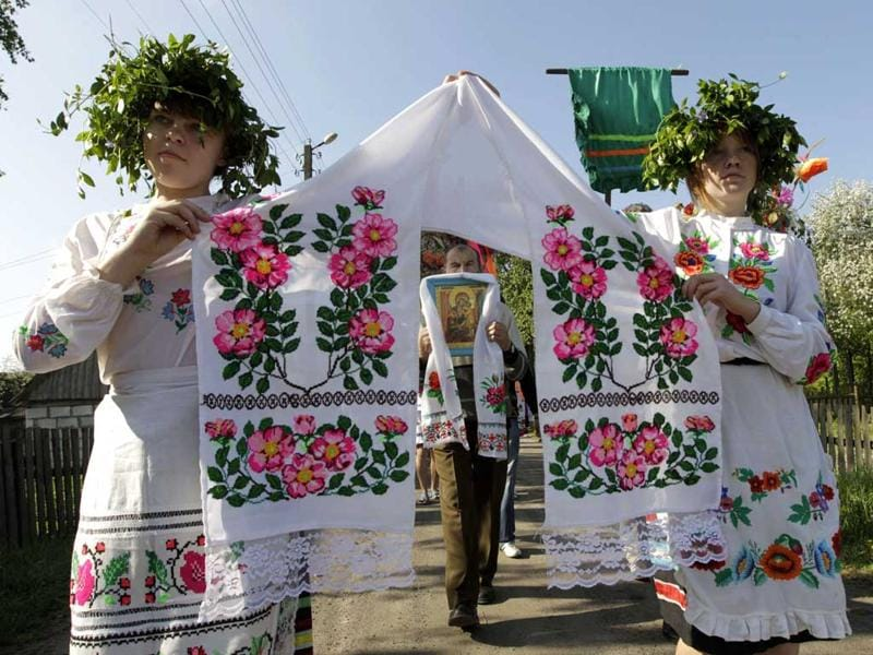 Villagers in national dresses take part in a parade during a ritual celebrating the pagan god Yurya, in the village of Pogost, some 250 km (155 miles) south of Minsk, Belarus. REUTERS/Vasily Fedosenko