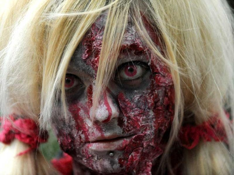 A girl dressed as a zombie participates in a zombie walk in Prague. AFP/Michal Cizek