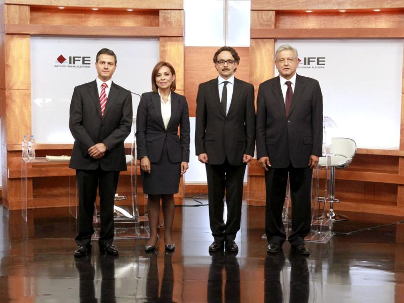 In this photo released by Mexico's Federal Electoral Institute (IFE), presidential candidates (L to R) Enrique Pena Nieto (Revolutionary Institutional Party, PRI), Josefina Vazquez Mota (National Action Party, PAN), Gabriel Quadri (New Alliance Party, PANAL) and Andres Manuel Lopez Obrador (Democratic Revolution Party and Workers Party, PRD,PT) pose for a group photo prior to the start of the first presidential debate in Mexico City. AP Photo/IFE