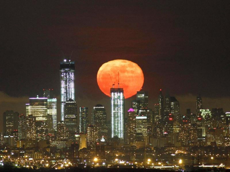 A full moon as seen from West Orange, New Jersey, rises over the skyline of Lower Manhattan and One World Trade Center (L) in New York. Reuters/Gary Hershorn