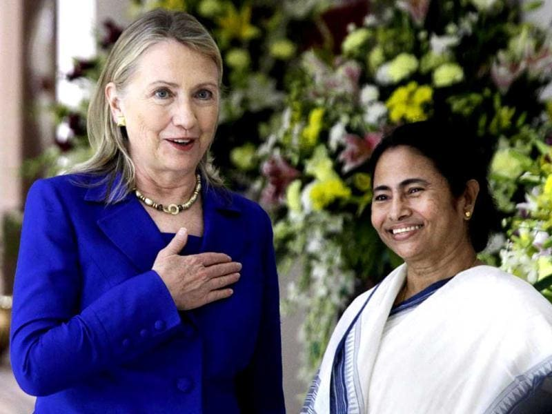 US secretary of state Hillary Rodham Clinton (L) gestures beside West Bengal chief minister Mamata Banerjee before a meeting in Kolkata. AP Photo/Bikas Das
