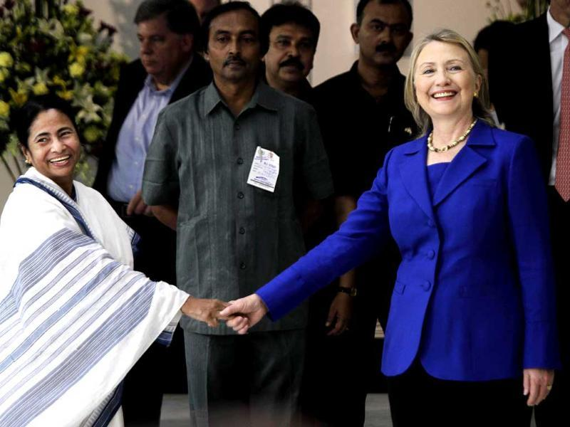 West Bengal chief minister Mamata Banerjee, left, shakes hands with US secretary of state Hillary Rodham Clinton before a meeting in Kolkata. (AP Photo/Bikas Das)