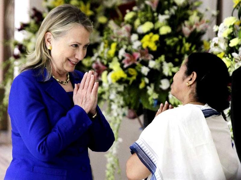 West Bengal chief minister Mamata Banerjee and US secretary of state Hillary Rodham Clinton greet each other before a meeting in Kolkata. (AP Photo/Bikas Das)