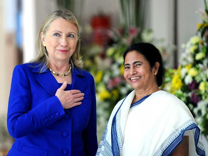US Secretary of State Hillary Clinton looks on with West Bengal state Chief Minister Mamata Banerjee at the Writers' Building, which houses the state secretariat, in Kolkata. AFP PHOTO/Dibyangshu SARKAR