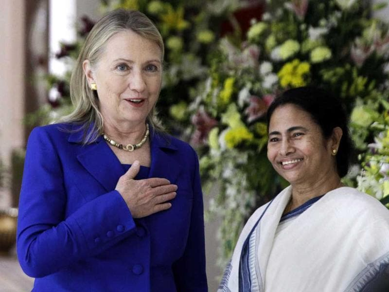 US secretary of State Hillary Rodham Clinton, left, gestures beside West Bengal chief minister Mamata Banerjee before a meeting in Kolkata. (AP Photo/Bikas Das)