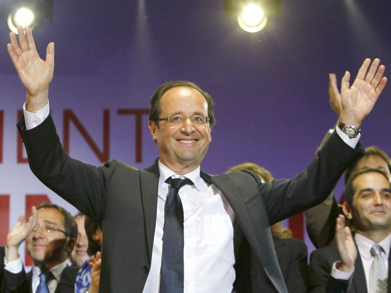 France's newly-elected President Francois Hollande arrives at his campaign headquarters in Paris, the day after his election. Reuters/Jean-Paul Pelissier