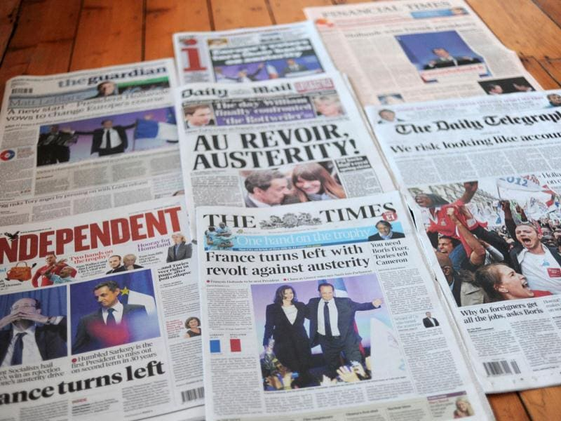 This picture shows the front pages of British newspapers featuring the winner of the second round of the French 2012 presidential election, Socialist challenger Francois Hollande.AFP Photo/Carl Court