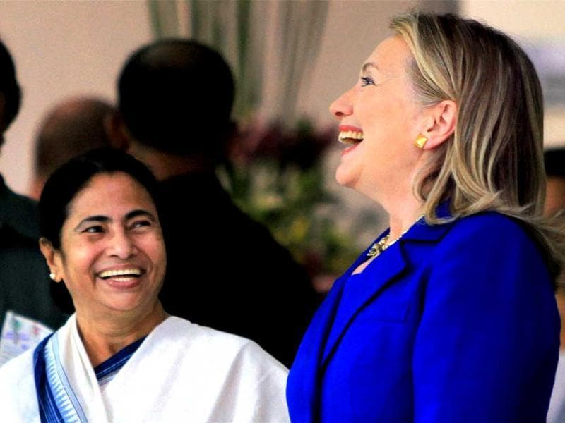 West Bengal chief minister Mamata Banerjee and US secretary of state Hillary Clinton share a laugh before their meeting at State Secretariat building in Kolkata. PTI Photo by Swapan Mahapatra