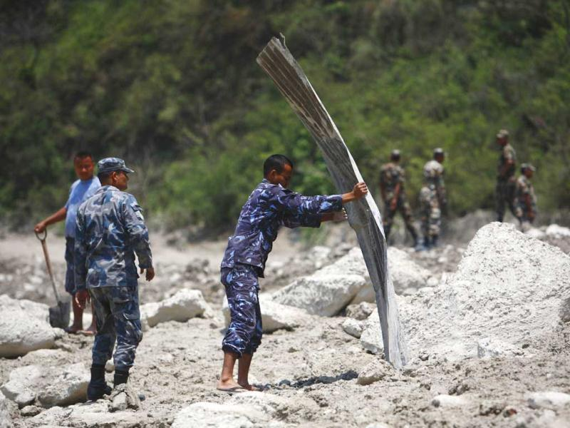 Rescue team members from the Nepalese police work in a search operation at a site that used to be a small village, swept away by a flash flood caused by an avalanche in the Annapurna mountain range on Saturday, in Kaski district. At least 19 people, including three foreigners, are confirmed to have died and 45 still missing till today due to the flood in Pokhara and adjoining villages in Kaski district, according to local media report. (Reuters)