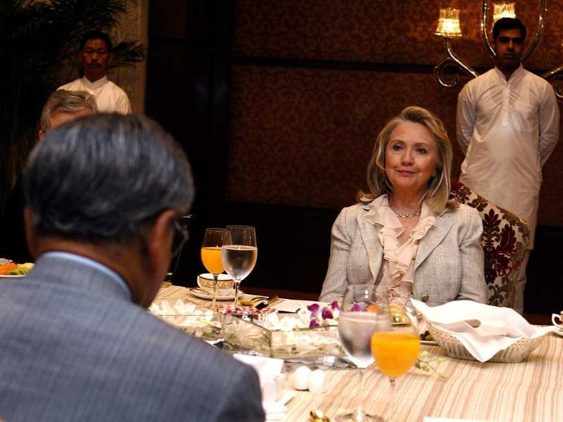 US secretary of state Hillary Clinton listens as India's minister for external affairs SM Krishna speaks at a breakfast meeting in New Delhi. AFP PHOTO/Shannon Stapleton/POOL