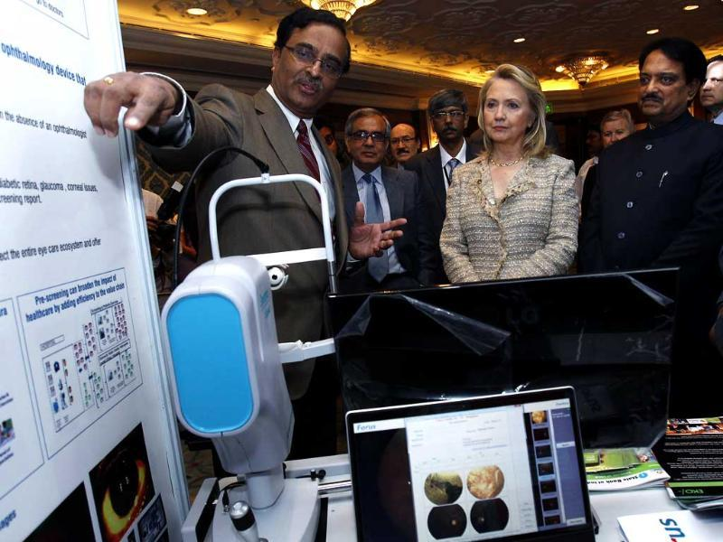 US secretary of state Hillary Clinton and India's minister of science and technology Vilsaro Deshmukh attend the US-India Partnering for Innovative Solutions event in Delhi. REUTERS/Shannon Stapleton