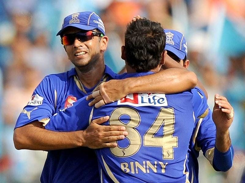 Rajasthan Royals captain Rahul Dravid (L) celebrates with bowler Stuart Binny after taking the wicket of Pune Warriors India batsman Michael Clarke during the IPL Twenty20 cricket match between Pune Warriors India and Rajasthan Royals at The Sahara Stadium in Pune. AFP Photo/Punit Paranjpe