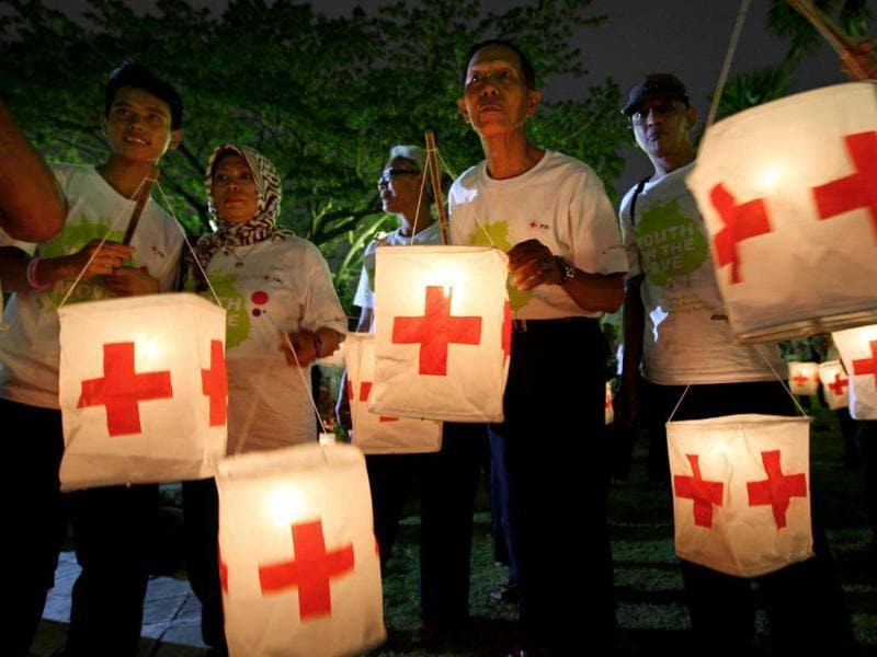 Indonesians hold lanterns during a ceremony commemorating the World Red Cross Day at in Jakarta. AP Photo/Dita Alangkara
