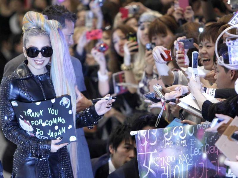 Singer Lady Gaga reacts as she signs autographs for fans upon her arrival at Narita international airport in Narita. (Reuters/Toru Hanai)