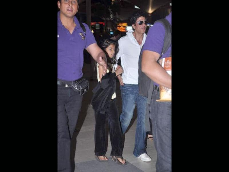 Suhana holds on to daddy as they enter the airport.