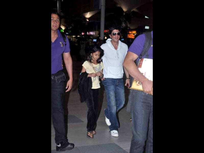 Shah Rukh smiles at the camera while daughter Suhana quietly walks away.
