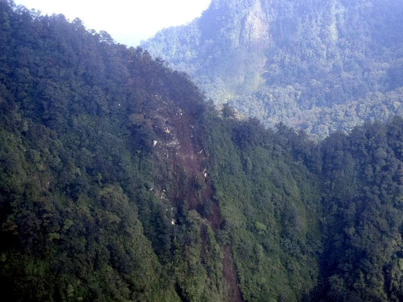In this photo released by Indonesian Air Force, the wreckage of a missing Sukhoi Superjet-100 are scattered on the mountainside in Bogor, West Java, Indonesia. AP Photo