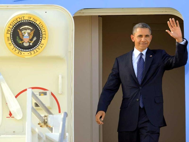 President Barack Obama waves as he arrives at Los Angeles International Airport in Los Angeles. Obama is traveling to the West Coast for a series of campaign fundraisers. AP Photo/Mark J Terrill