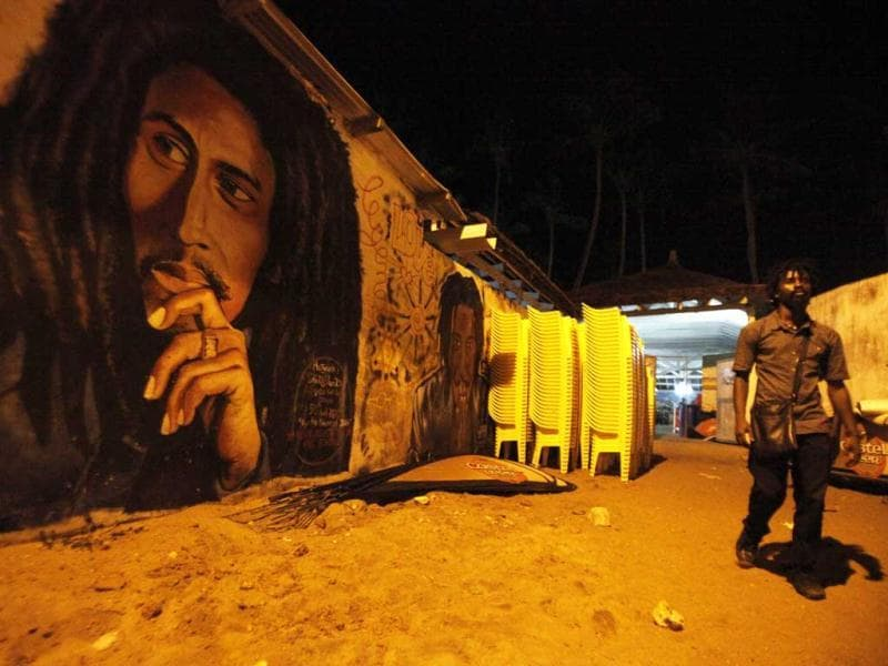 A man walks past a portrait of Bob Marley in Vridi's Village Rasta, Abidjan. Reuters/ Thierry Gouegnon