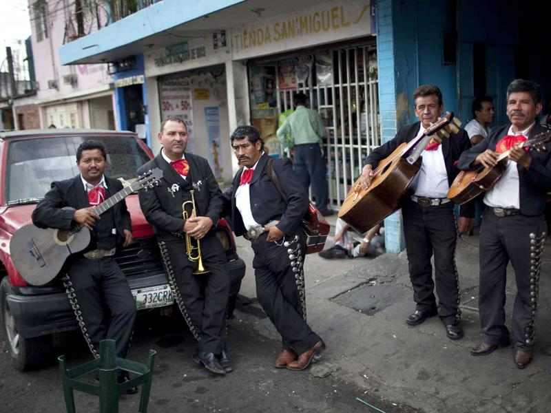 Mariachi musicians wait to perform for a client during Mother's Day celebrations in Guatemala City. AP/Rodrigo Abd