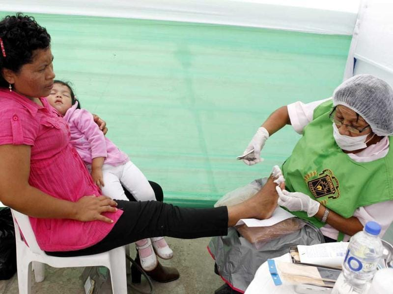 A woman is prepared for a pedicure during Mother's Day celebrations in Ventanilla district in Lima. Reuters/Mariana Bazo