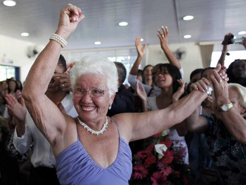 A contestant dances next to relatives and friends during a beauty contest for elderly women, in honour of Mother's Day in Sao Paulo. Reuters/Nacho Doce
