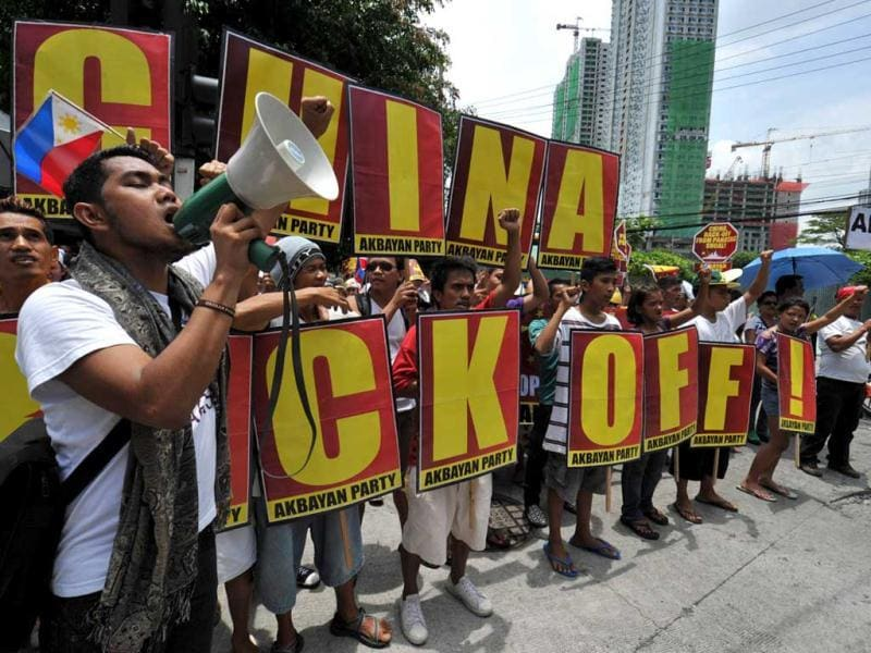 Protesters holding placards shout anti-China slogans during rally in front of the Chinese consulate in the financial district of Manila. Hundreds of Filipinos demonstrated outside the Chinese embassy in the Philippines, over an escalating territorial row, with the protesters denouncing China's rulers as arrogant bullies. AFP Photo/Ted Aljibe