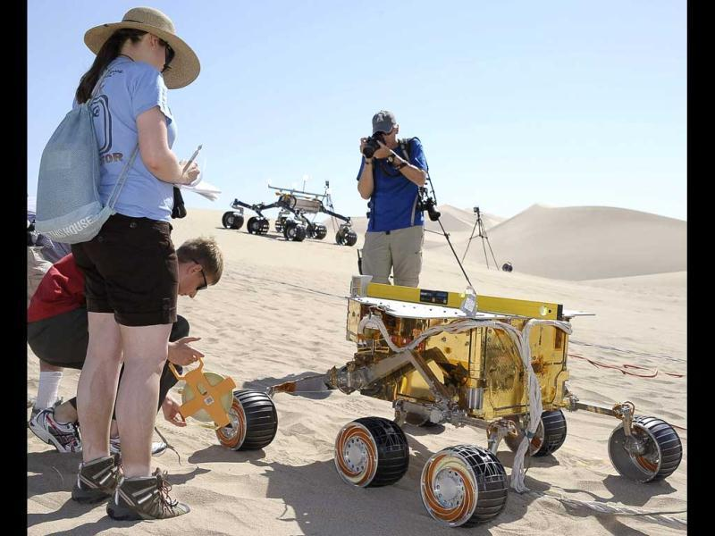 Members of the Mars Science Laboratory run a test between an engineering model of the current rover on Mars (front) and its successor, dubbed