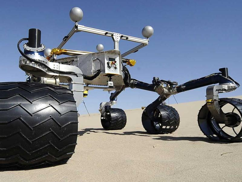 Members of the Mars Science Laborator test out an engineering model of its next generation Mars rover, dubbed